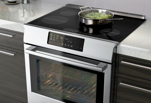 Bosch Induction Range With Food On Cooktop